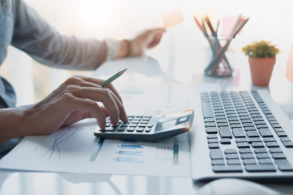 Businessman working on calculator