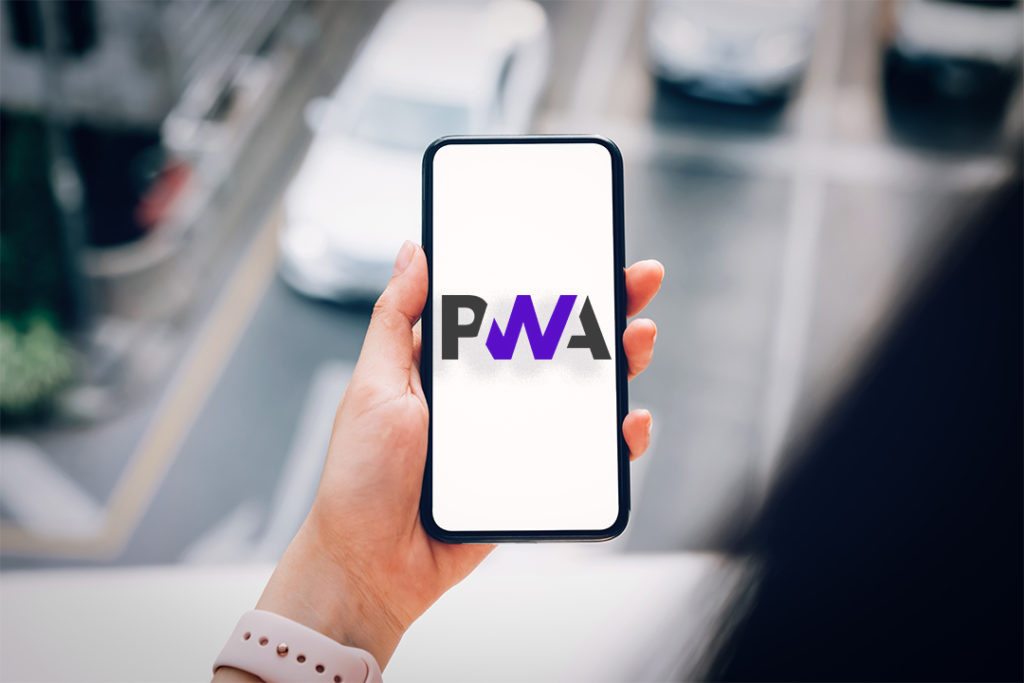 Woman holding a smartphone with the PWA word on the screen