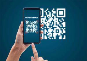 Hand using mobile smart phone scan QR code mockup template